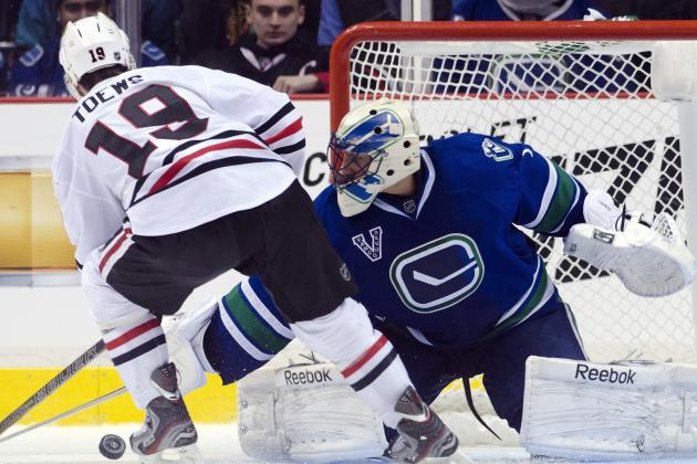 Blackhawks Lose to Canucks in Shootout; Dave Bolland Injured