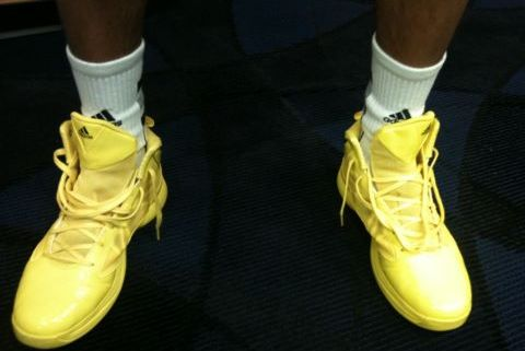 Burke Models U-M's Maize Colored Shoes