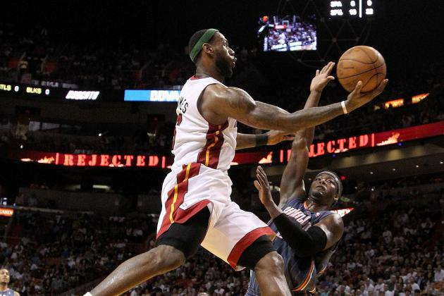 James Nearly Perfect as Heat Hold off Bobcats 99-94