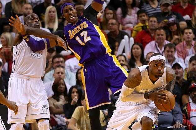 LeBron James and Dwight Howard Moving in Opposite Directions