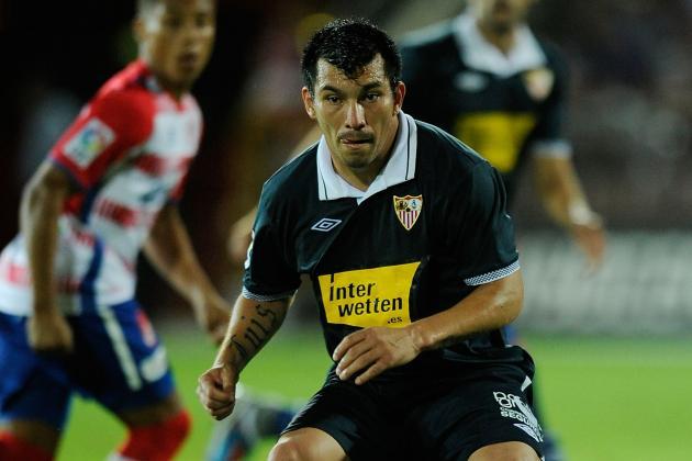 Soccer-Sevilla Beat Deportivo 3-1 to Boost European Hopes