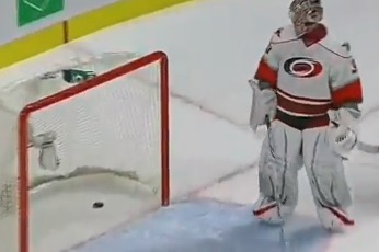 Cam Ward Is Bested by a Bouncing Puck Shot from Behind the Red Line