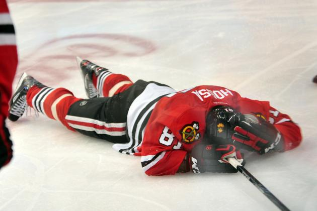 NHL Must Suspend Jannik Hansen for Reckless Elbow on Blackhawks' Marian Hossa