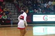 Cheerleader Sinks Incredible Half-Court Trick Shot in Mid-Flip