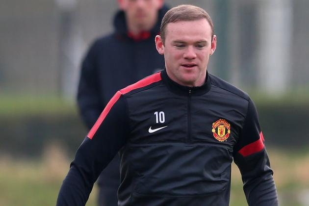Rooney Brushes off Illness to Launch into Tackle on Vidic During United Training