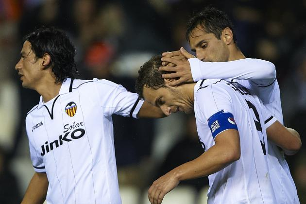 Soccer-Valencia Fight Back for Draw Thanks to Jonas Double