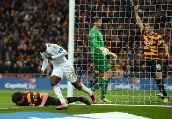 Nathan Dyer wheels away after opening the scoring for Swansea.