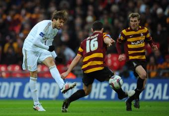 Michu scores Swansea's second goal.