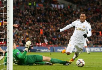 Jonathan de Guzman is felled by Bradford goalkeeper Matt Duke.