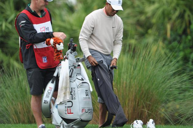 Tiger Woods Changes Clothes and Hits Shot out of Water