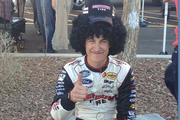 Joey Logano Goofing Around at a Discount Tires Photo Shoot