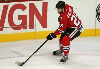 Hawks are unable to get a stick on the rebound created by Viktor Stalberg's shot.