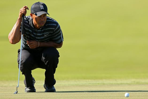 Woods Leads, Rory Struggles