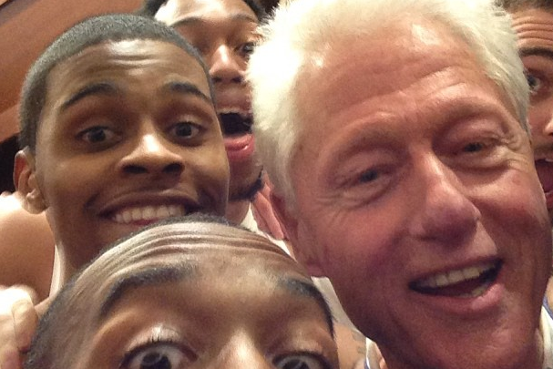 Louisville Cardinals Celebrate with Bill Clinton Following Big East Tourney Win