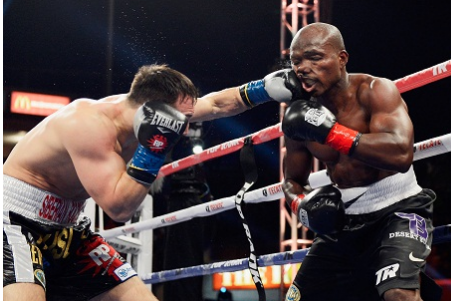 Unbeaten Bradley Keeps Title with Narrow Escape