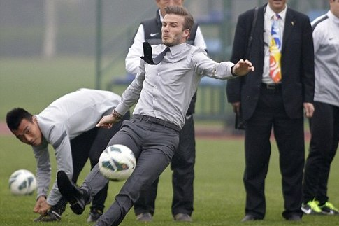 Showing Chinese Kids How to Take the Perfect Free-Kick, Beckham Slips Up