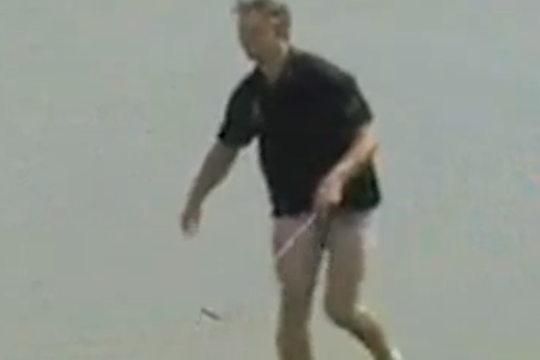 Here Is a Professional Golfer Hitting a Chip Shot While Pants-Less