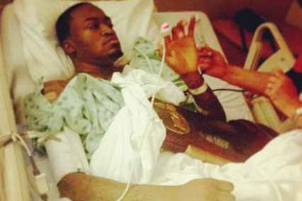 Kevin Ware Holding His Team's Regional Championship Trophy