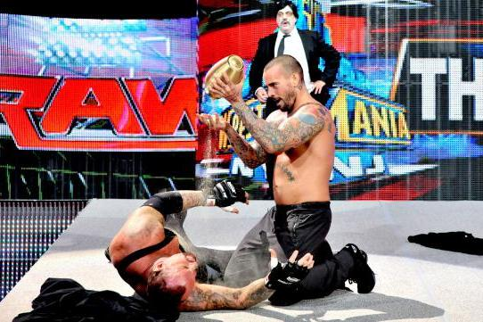 WWE Raw, April 1: CM Punk Attacks Undertaker as Build for WrestleMania Continues