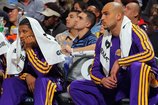 Lakers Recall Morris, Sacre