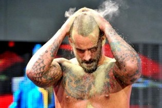 WWE WrestleMania XXIX: CM Punk Bathes in Bearer's Fake Ashes, Fans Flip out
