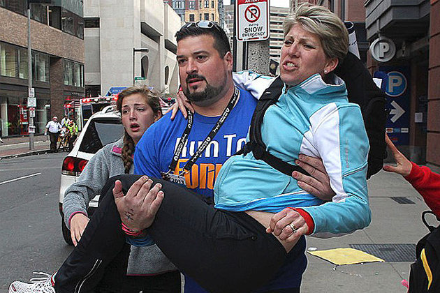 Former New England Patriot Joe Andruzzi Assists Survivors at Boston Marathon