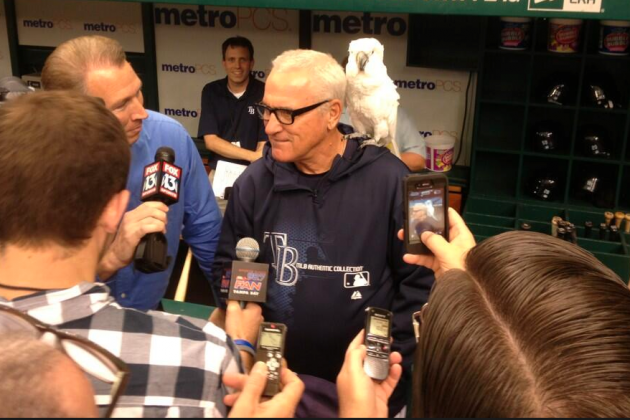 Joe Maddon Hangs out with a Cockatoo