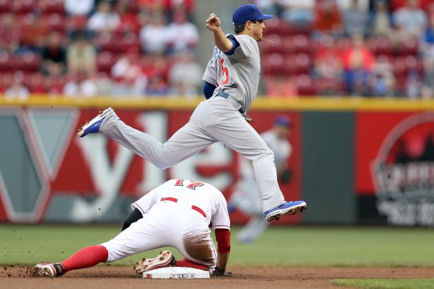 Cubs Beat Reds 4-2 in 10 Innings