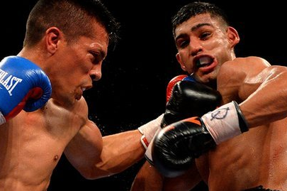 Khan Battles to Tough Diaz Victory