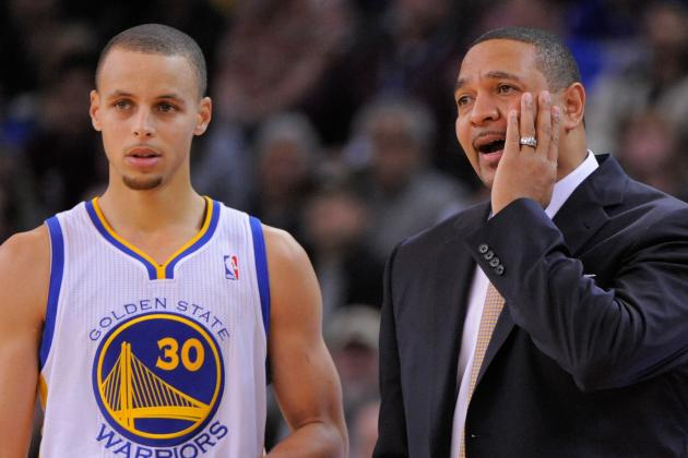 Stephen Curry Tries to Sneak Brace off Behind Mark Jackson's Back