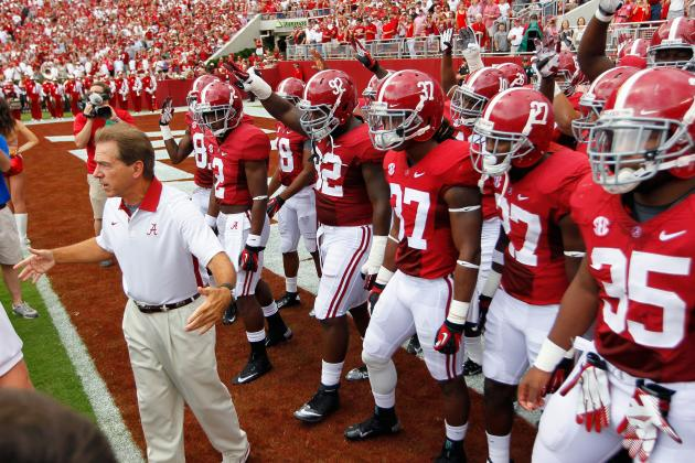 What College Football's Early Week 1 Point Spreads Tell Us