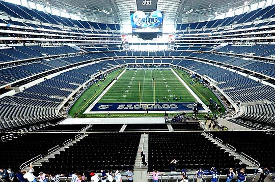 Notre Dame Head Coach Brian Kelly Takes in Cowboys Stadium
