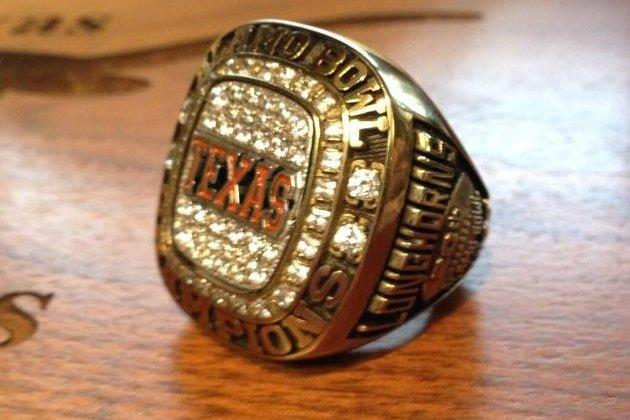 Mack Brown Hands out Rings to His Players for Winning Alamo Bowl