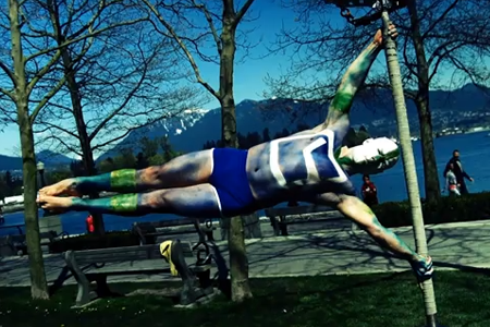 Cirque Du Soleil Acrobat Becomes Human Flag to Support Vancouver Canucks (Video)