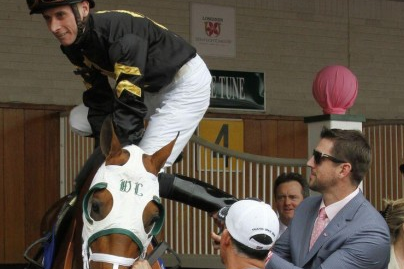 Aaron Rodgrers Helps Jockey on to His Horse