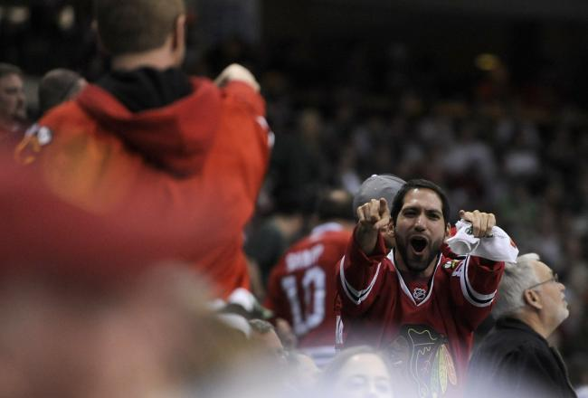 A Blackhawks' fan celebrates one of the three goals scored by Chicago. The building was utterly silent otherwise.