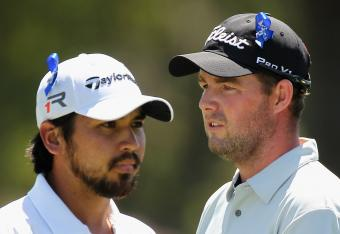 Marc Leishman (right) talks things over with fellow Aussie, Jason Day.