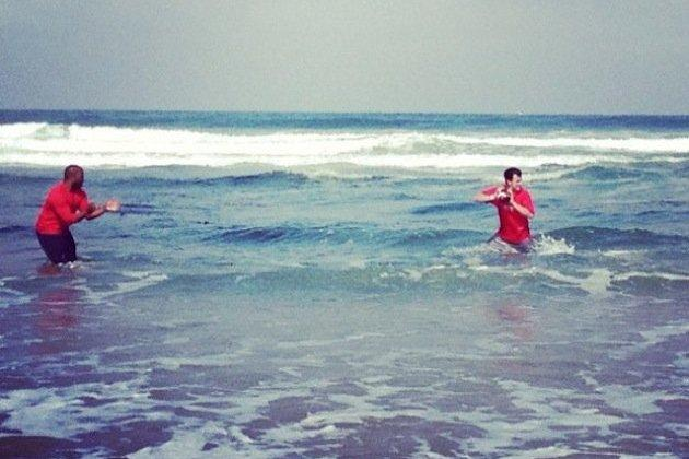 Johnny Manziel Battles Waves as He Works Toward His Next Heisman (Photo)