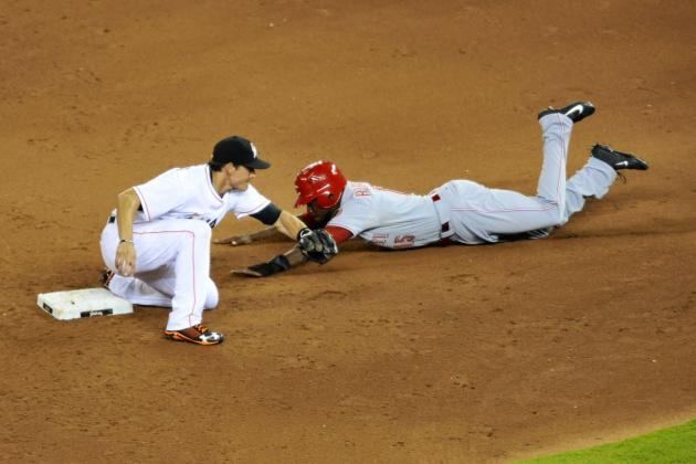 Phillips Helps Reds Finish Sweep of Marlins