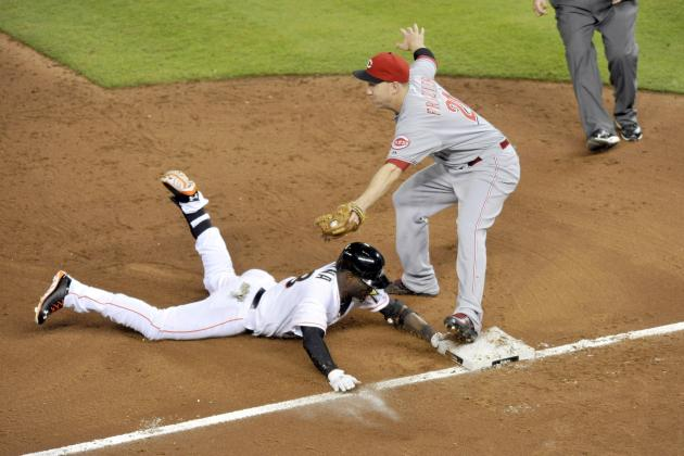 Miami Marlins' Late Rally Spoiled by Reds in 10th Inning Loss