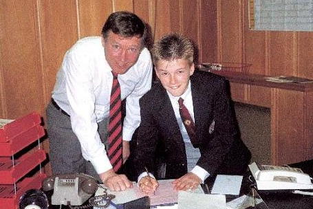 Here's a Spiky-Haired, 14-Year-Old Beckham Signing for Man Utd