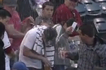 Fans Demonstrates Why You Shouldn't Try to Catch a Baseball with a Full Beer