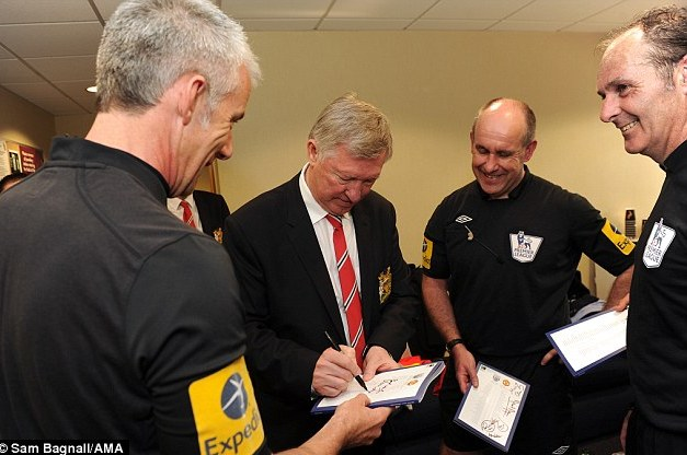Team of Officials Queue for Ferguson's Autograph After Final Game in Charge