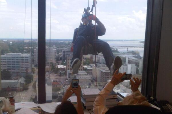 Les Miles Rappelling Down the Side of a 24-Story Building