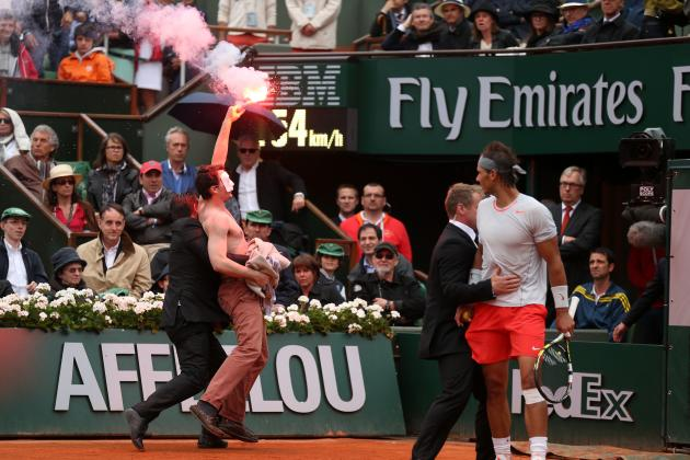 Shirtless Fan With A Flare Runs On The Court At the French Open