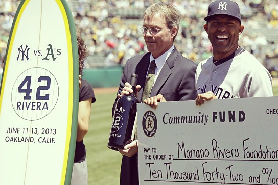 Yankees' Mariano Rivera Is Given a Surfboard from the Oakland A's
