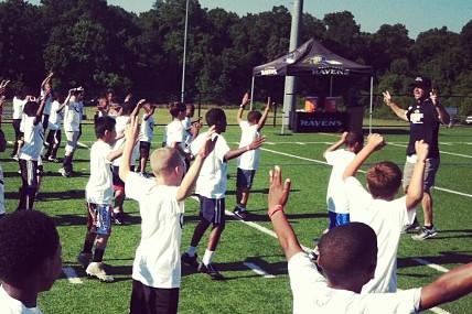 John Harbaugh Puts Kids to Work at Ravens Football Clinic