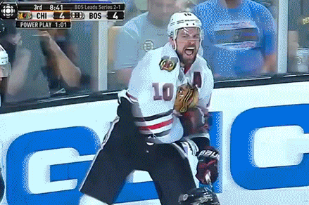 GIF: Patrick Sharp Falls Down While Trying to Fist Pump