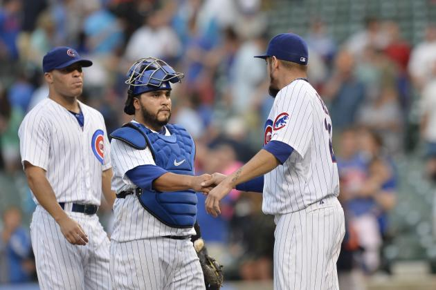 Garza, Rizzo Lead Cubs Past Astros After Delay