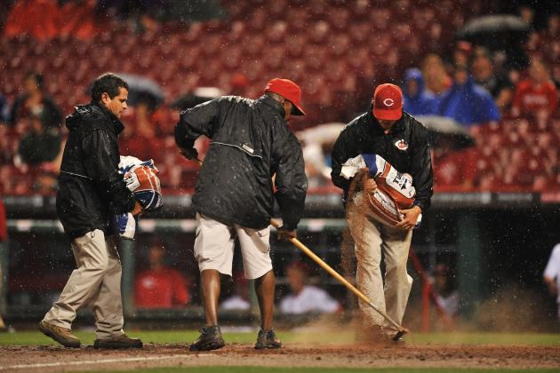 Reds Pound Giants in Rain-Shortened Game